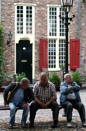 master: Netherlands, Harderwijk,-june 2016:older residents on a bench on the Master ports brink