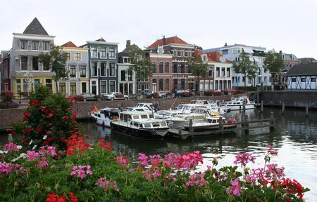Netherlands, Gorinchem, Gorkum, June 2016: houses and the sluice in the ferry port