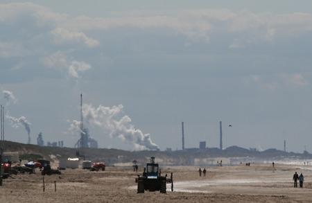 Corus Steel blast furnaces, industrial area seen from the beach of Egmond aan Zee Stock Photo