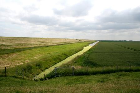 De dijk in zijn landschap
