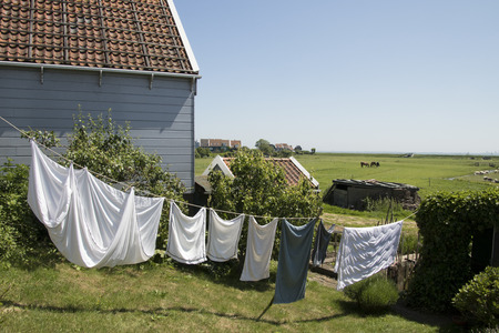 Netherlands,North Holland,Marken, june2016: laundry on the line  and meadows and rural land in the island of Marken 報道画像