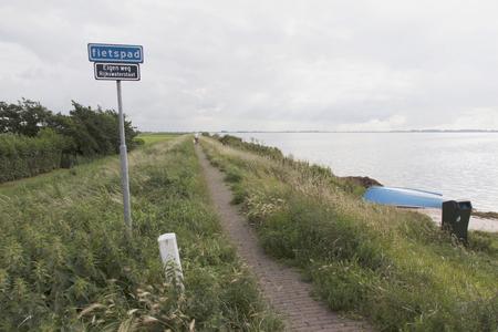 Netherlands,North Holland,Marken, june2016: Walking path along the dike in Marken 写真素材