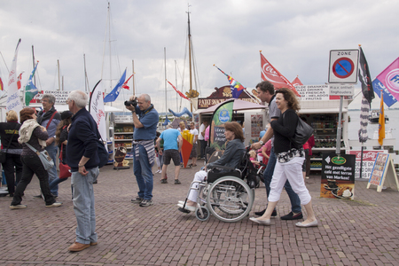 Tourists in the neighbouring harbour of Marken Editorial