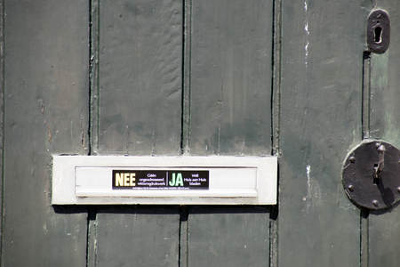 Netherlands,North Holland,Marken, june2016:  wooden door with sticker for the mail-man