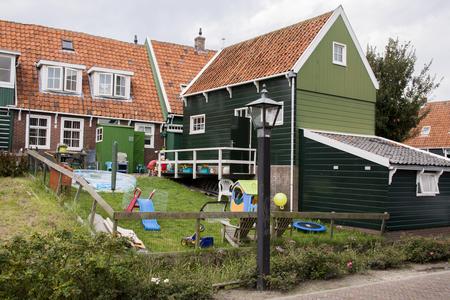 Netherlands,North Holland,Marken, june2016: children playing in the garden