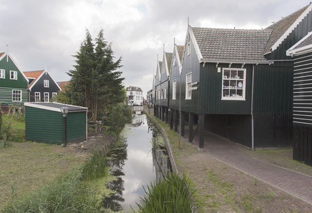 Netherlands,North Holland,Marken, june2016: Ditch along the houses in the port neighborhood of Marken.