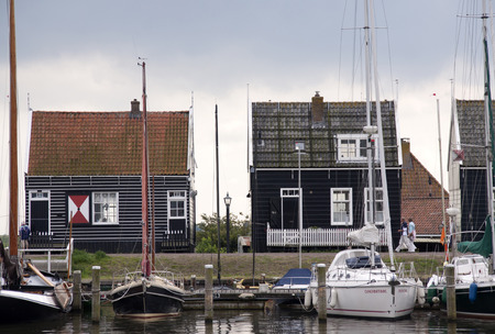 Netherlands,North Holland,Marken, june2016:Wooden fishing boats and houses in the port area 報道画像