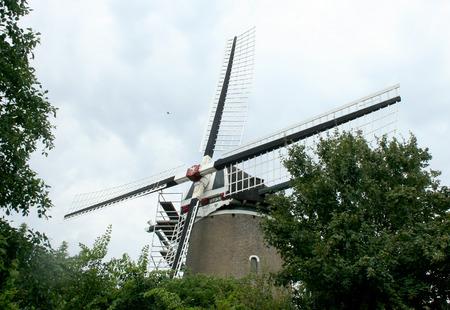 Netherlands,zeeland Brouwershaven,june,2016:Cornmill de Haan, an old historic windmill in the town of Brouwershaven 報道画像