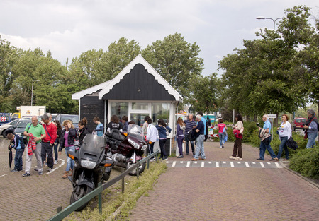 Netherlands,North Holland,Marken, june2016: Netherlands,North Holland,Marken: 2016: Tourist flows Marches through a small office in the parking lot