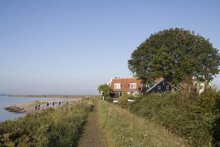 Netherlands,North Holland,Marken: Coastal road arround Marken 写真素材