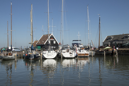 Netherlands,North Holland,Marken, june2016: the harbor is the busiest part of th village 報道画像
