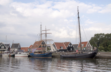 Wooden fishing boats and houses in the port area