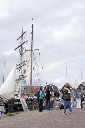 Netherlands,North Holland,Marken, june2016: Tourists in the harbour of Marken