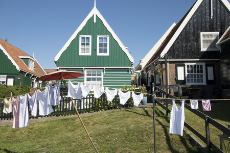 Netherlands,North Holland,Marken, june2016: laundry on the clothes-lineResidential area on elevated ground, Yard called