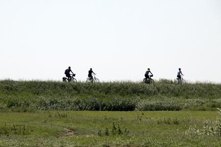 Netherlands,North Holland,Marken, june2016: bikers over the small dike of Marken