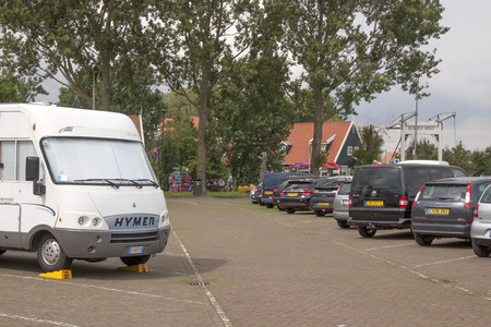 Netherlands,North Holland,Marken, june2016: Campers stay in the parking lot