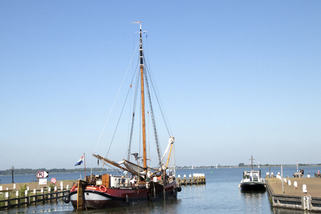 Netherlands,North Holland,Marken, june2016: the harbor is the busiest part of the village. Yacht getting ready to sail into sea