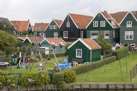 Netherlands,North Holland,Marken, june2016: Children play freely in spite of the mass tourism
