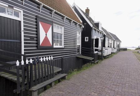 Netherlands,North Holland,Marken, june2016: Typical Marker wooden  homes on the seaside promenade of Marken