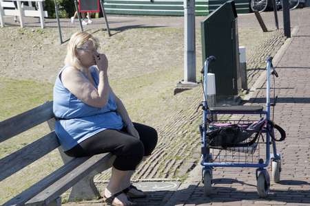 Netherlands,North Holland,Marken, june2016: Eldery woman  in the port area 報道画像