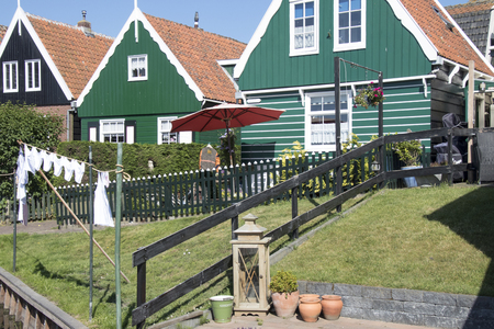 Netherlands,North Holland,Marken, june2016: Residential area on elevated ground, Yard called