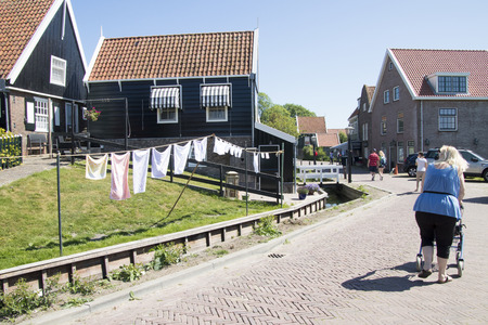 Netherlands,North Holland,Marken, june2016: laundry on the clothes-line.Mass tourism in the village 報道画像