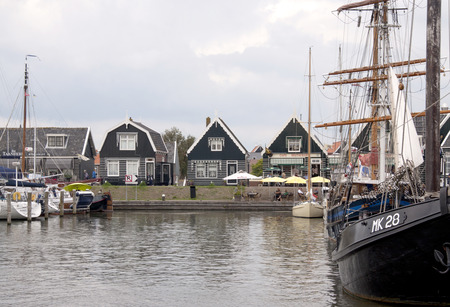 Netherlands,North Holland,Marken, june2016:Wooden fishing boats and houses in the port area 写真素材
