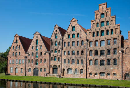 Old traditional houses on the edge of the old city of Lübeck Editorial