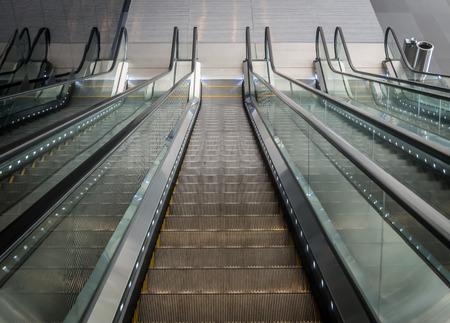 Moving down on escalators in mall Banco de Imagens