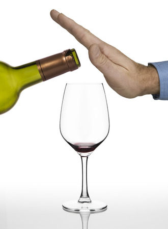 drink and drive: Hand of a man refusing anymore red wine on white background