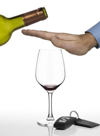 alcohol drinks: Hand of a man refusing anymore red wine and showing car keys on a white background Stock Photo