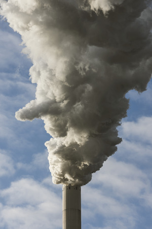 coal fired: Large cloud of smoke from coal fired power plant against blue clouded sky