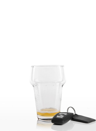 pilsener: Empty beer glass next to car keys on a white background Stock Photo