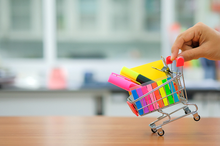 Back to school and Education concepts with shopping cart, pencil, highlighter and notepad
