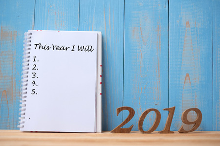 "2019 Happy New years with notebook "" This Year I Will "" text and wooden number on table and copy space. New Start, Resolution, Goals and Mission Concept Foto de archivo"