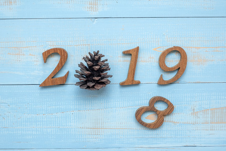 2018 - 2019 number with Christmas decorations on wooden background, Business Goals, Mission, Resolution, New Year New You concept Stock Photo