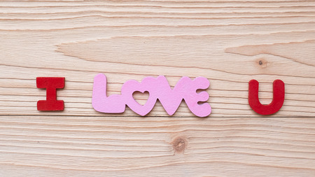 I Love U text on wooden table background. romantic and Valentine Day holiday Concept
