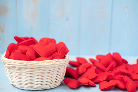 red heart shape decoration in basket on blue wooden table background. Love, Wedding, Romantic and Happy Valentine' s day holiday concept