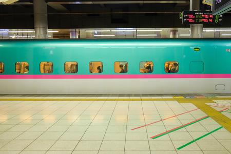 passenger in Japanese Shinkansen high-speed bullet departing from Ueno staion; Ueno, Tokyo,  JAPAN  8 April 2018 Редакционное