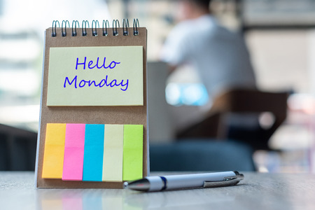 Hello Monday text on note paper or empty reminder template on wooden table. New Goal New Start concept Stock Photo