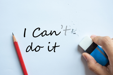 Businessman erasing I can't do it text change to I can do it, positive thinking and success concept