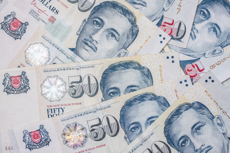 Fifty Singapore Dollars banknote. business, investment, retirement planning, finance and Saving for the future concepts
