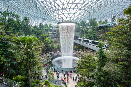 The Giant water fall HSBC Rain Vortex and beautiful green nature Shiseido Forest Valley in the Jewel Changi Airport, link to terminal Changi international Airport in Singapore; Singapore, 11 May 2019 Editorial