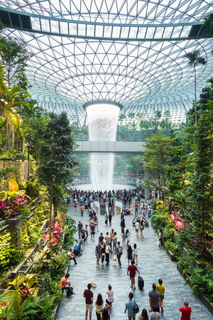 The Giant water fall HSBC Rain Vortex and beautiful green nature Shiseido Forest Valley in the Jewel Changi Airport, link to terminal Changi international Airport in Singapore; Singapore, 11 May 2019 報道画像