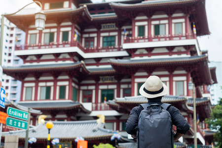 man hipster traveling with backpack and hat, Solo traveler looking to Buddha Tooth Relic Temple Reklamní fotografie
