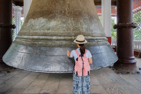 woman travelling with bag visit Mingun Bell located in Mingun, Sagaing Region, near Mandalay and Irrawaddy River. It was the heaviest functioning bell in the world at several times in history. Banco de Imagens - 128728094
