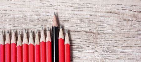 Black pencil different from crowd of red pencils. Unique Leader, strategy, independence, think different, business and success concept