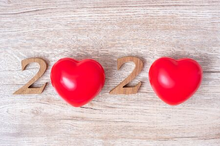 2020 number with red heart shape  on wooden background, health, Insurance and New Year New You concept