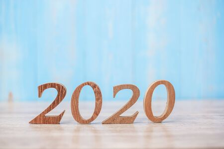2020 wooden number on blue table background with copy space for text. Business Goals, Mission, Resolution, New Year and New start concept