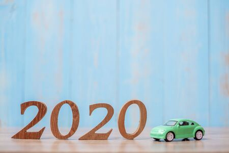 2020 Happy New Year with Car on wood table background with copy space. financial, money, refinance, Car for cash and Car insurance concept